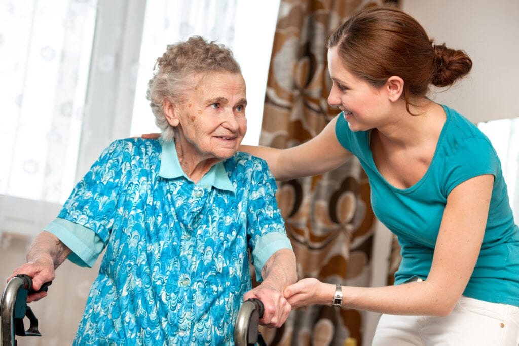 Senior woman with her alzheimer's caregiver in west palm beach at home
